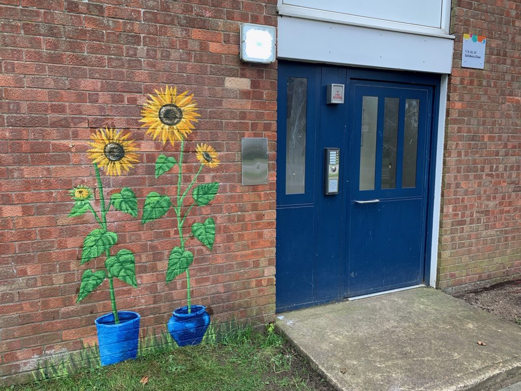 sunflowers on the wall of an Ongo building on the Westcliff estate, Scunthorpe