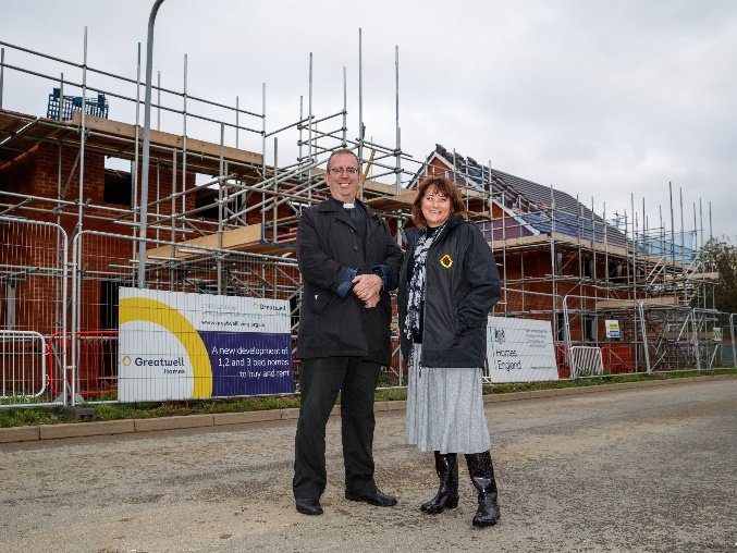 Greatwell Homes chief executive Jo Savage and patron Revd Richard Coles at the construction site of Lakeland Meadows in October 2019