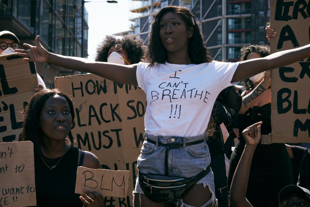 black lives matter protest in london - woman wearing a white t-shirt that reads i can't breathe