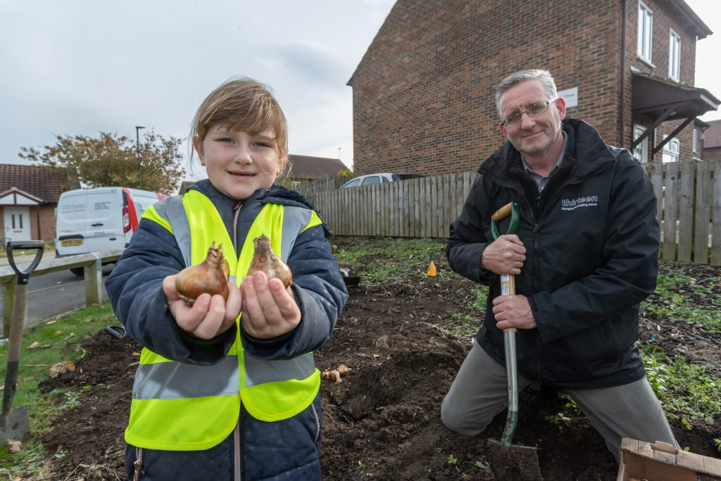 Village blossoms after housing provider teams up with local school